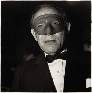 Diane Arbus,Masked man at a ball, New York, 1967