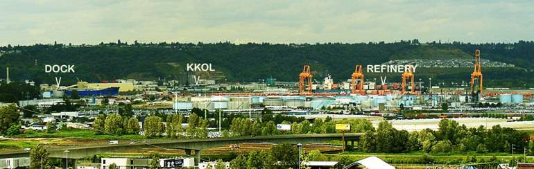 Wide_view_tanker_towers_refinery_wi
